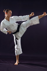 karateka girl on black background studio shot