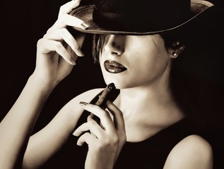 Vintage woman with a hat and cigar
