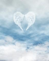 Angel Wings in Cloudy Blue Sky