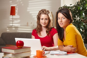 Schoolgirls learning at home