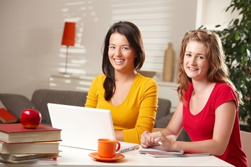 Portrait of two girls with laptop
