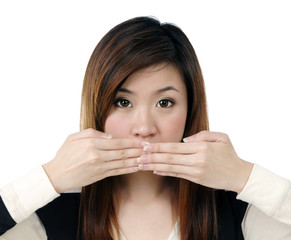 Beautiful young woman covering her mouth with both hands