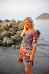 Young pretty woman enjoing the evening on the beach