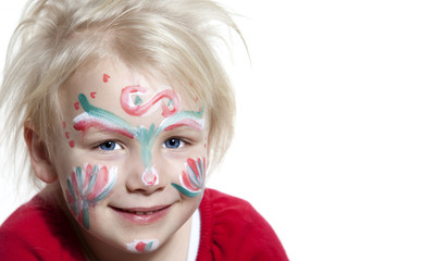 Sweet blond child with painted face