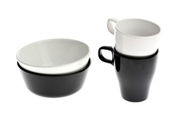 Two black and white ceramic bowls and cups isolated on white