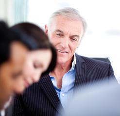 Confident senior businessman in a meeting