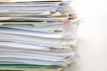 Stack of files full of documents