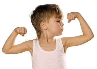 Little boy flexing biceps