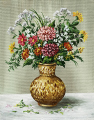 Bunch of flowers in a African vase