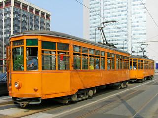 Old orange trams in Milan