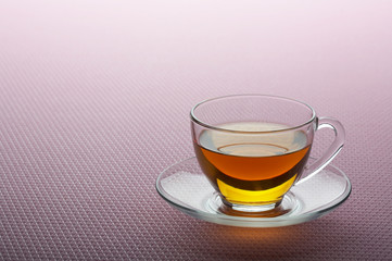 Tea cup on pink background
