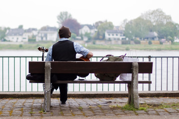 Busker on a bench