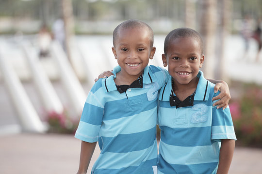 Two young brothers hugging