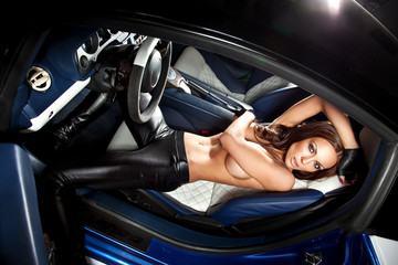 Sexy woman sitting in a sport car