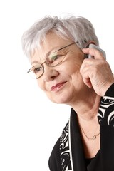 Closeup portrait of older woman with mobile phone