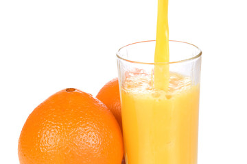 oranges and half juice in glass