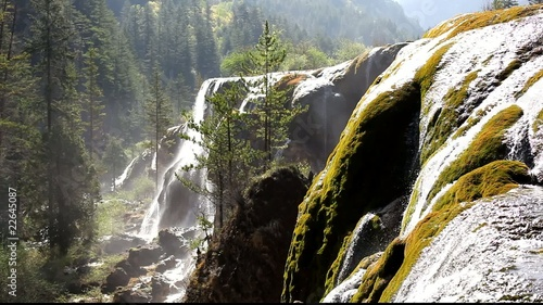 Waterfall Cascading in Nine-Village Valley, Sichuan, China скачать