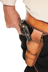A cocked pistol pulled out of a leather holster