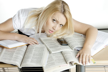 portrait of student lying in books
