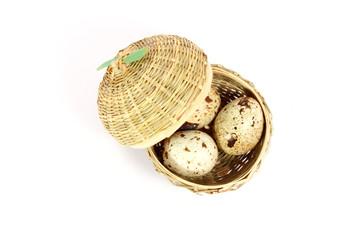 Three eggs in a little basket