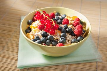 fresh berries in wood bowl