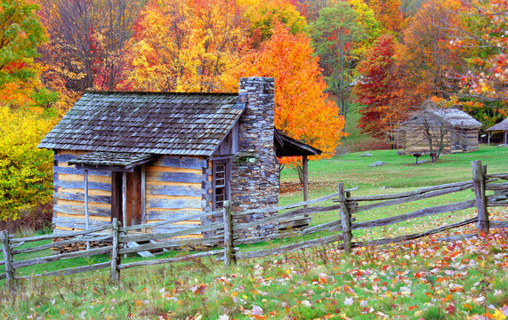 Log cabins during autumn in the mountains.