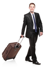 Business traveler carrying a suitcase isolated on white