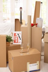 Pile of boxes and champagne in new house