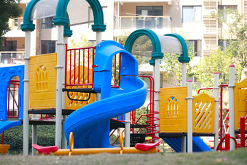 Beautiful and colorful playground on a quiet sunny day .