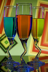 Bright colorful glasses with curved stems