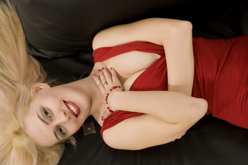 Young woman on black sofa