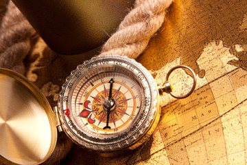 Old Compass and rope on map
