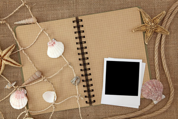 Fishing net and exercise book on brown background