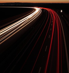 Night highway (Cars in a rush moving fast on a highway)