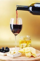 Red wine cheese and olives.