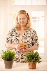 Woman holding orange juice