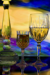 Crystal glasses on abstract color background