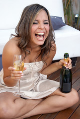 The laughing emotional Latin girl with champagne