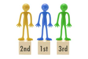 Miniature Rubber Figures on Podium