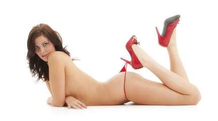 Beautiful naked brunette in red high heel shoes
