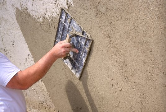 Plastering a wall outside