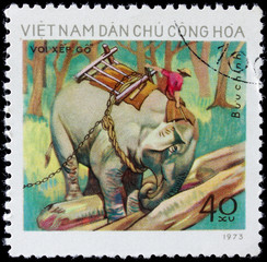 post stamp shows people on elephant