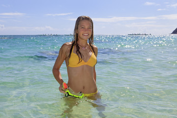 teenage girl in the ocean with mask and snorkel.