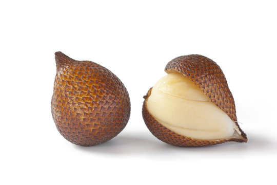 One and a half snakefruit at white background
