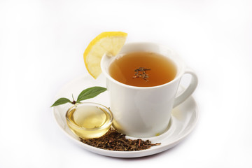 a cup of green tea with honey and lemon