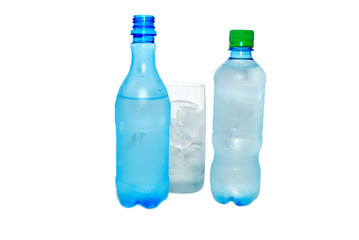 Two bottles with cold water and an ice in a glass