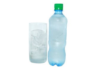 Bottle with cold water and an ice in a glass