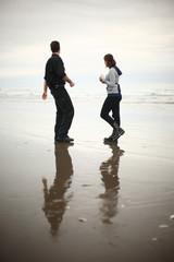 A young couple enjoying the beach.
