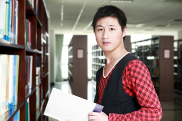 asian boy studying in library
