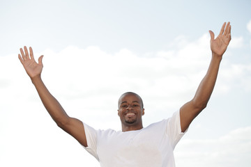African American man with arms outstretched